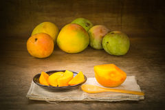 Organic mangos. Still life with group of organic mangos on wooden background Royalty Free Stock Photography
