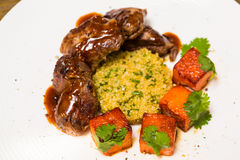 Organic meat of lamb cooked with slices pumpkin Stock Photos