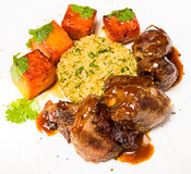Organic meat of lamb cooked with slices pumpkin Stock Photo