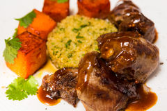 Organic meat of lamb cooked with slices pumpkin Royalty Free Stock Photography
