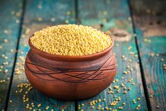 Organic Millet Seeds In A Ceramic Bowl Stock Photo