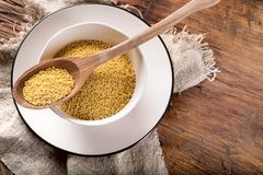 Organic millet seeds on rustic wooden tablу Stock Image