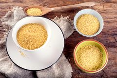 Organic millet seeds on rustic wooden table Royalty Free Stock Photos