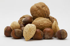 Organic mixed nuts on a white background Stock Photography
