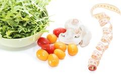 Organic mushrooms. Health food. Fresh mushrooms and arugula salad, cherry tomatoes royalty free stock image