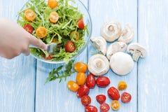 Organic mushrooms. Health food. Fresh mushrooms and arugula salad, cherry tomatoes stock photo