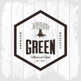 Organic natural and healthy farm fresh food retro emblem. Vintage olive tree logo isolated on white wood board background. Premium quality loft grunge Royalty Free Stock Images