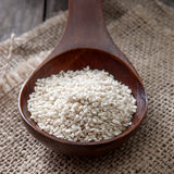 Organic Natural Sesame Seeds On Wooden Spoon Royalty Free Stock Photo