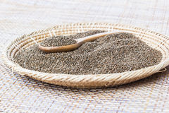 Organic natural sesame seeds on wooden spoon Stock Images