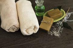 Organic natural soap. With towel and oil Royalty Free Stock Image