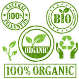 Organic and natural symbol. Organic and natural rubber stamp stock illustration