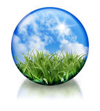 Organic, Nature Circle Orb Icon. A nature circle, orb icon has green grass and a bright blue sky in it. There is a reflection on the bottom. Use this for a Royalty Free Stock Photos