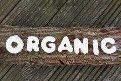 Organic Nature. The word organic on a wooden log Stock Photo