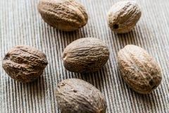 Organic Nutmeg or muskat on fabric surface. Stock Image