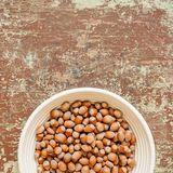 Organic nuts on old wooden background stock photo