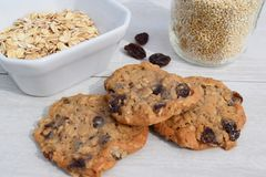 Organic oatmeal quinoa raisin cookies. Home-made organic oatmeal quinoa raisin cookies on white tabletop Royalty Free Stock Photography