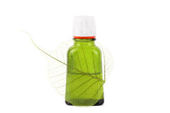 Organic oil with leaf close up. On the white isolated background Stock Images
