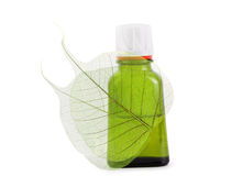 Organic oil with leaf close up Stock Photography