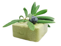 ORGANIC OLIVE SOAP. With olive branch isolated on white background stock image