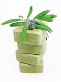 ORGANIC OLIVE SOAPS. With olive branch isolated on white background Royalty Free Stock Photo