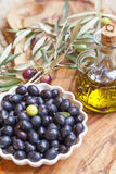 Organic olives with olive oil decoration Stock Photography