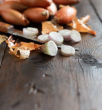 Organic  onion on wooden table Stock Images