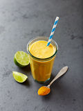 Organic orange and carrot smoothie with turmeric powder Stock Images