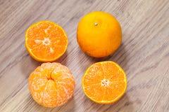 Organic orange fruit. on wooden background Stock Image