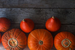 Organic orange pumpkins on wooden table, thanksgiving pumpkin background, autumn harvest Stock Image