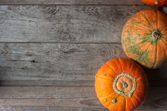 Organic orange pumpkins on wooden table, thanksgiving pumpkin background, autumn harvest Royalty Free Stock Photography