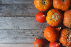 Organic orange pumpkins on wooden table, thanksgiving pumpkin background, autumn harvest Royalty Free Stock Images