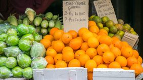 Organic oranges and other fruits for sale at market stock images