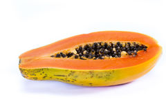 Organic papaya cut in half. Close up of an organic papaya cut in half showing the seeds isolate don a white background Stock Photos