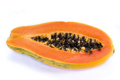 Organic papaya cut in half. Close up of an organic papaya cut in half showing the seeds isolate don a white background Royalty Free Stock Photo