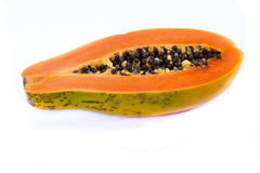 Organic papaya cut in half. Close up of an organic papaya cut in half showing the seeds isolate don a white background Royalty Free Stock Image