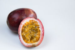 Organic passion fruit purple. Whole and half fruit Royalty Free Stock Photos
