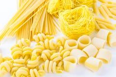 Organic pasta. Organic yellow pasta on a white background stock photo