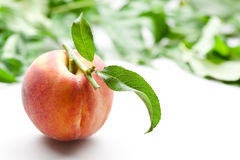 Organic peach with leaves; soft focus Royalty Free Stock Images