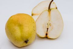 The organic pear on the white background. In the studio royalty free stock photo