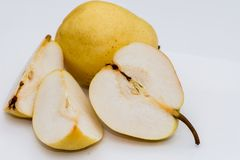 The organic pear on the white background. In the studio stock photography