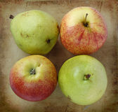 Organic pears and apples on an old rustic stone chopping board stock photos