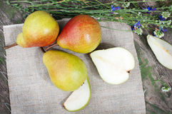 Organic pears on canvas with flowers Stock Image