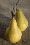 Organic pears closeup. Fresh organic pears closeup on old wooden board background stock photo