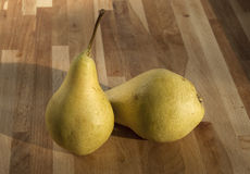 Organic pears closeup. Fresh organic pears closeup on wooden board background royalty free stock photos