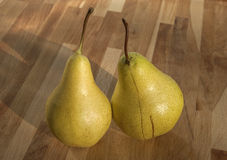 Organic pears closeup. Fresh organic pears closeup on wooden board background royalty free stock image