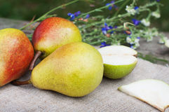 Organic pears with flowers Royalty Free Stock Photo