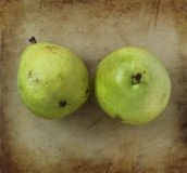 Organic pears on an old rustic stone chopping board Royalty Free Stock Image