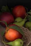 Organic pears and peaches on cloth Stock Photo
