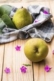 Organic pears on a rustic wooden table royalty free stock photos