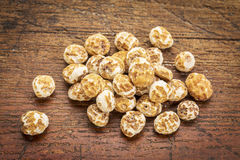 Organic peeled tiger nuts Stock Image